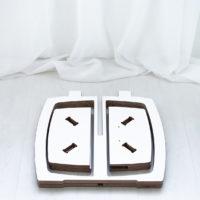 Opilion valkoinen design jakkara purettuna ns. flatpackiksi.